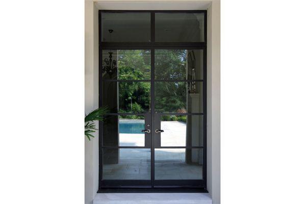 steel glass doors. Custom Steel And Glass Door Transom With Reflection Of Pool Terrace, Beyond Doors