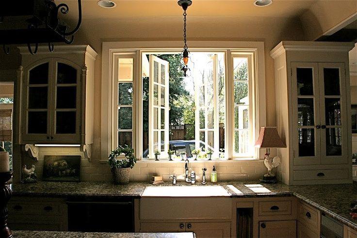 Kitchen bay window treatments love a kitchen window over for Kitchen window sill decoration ideas