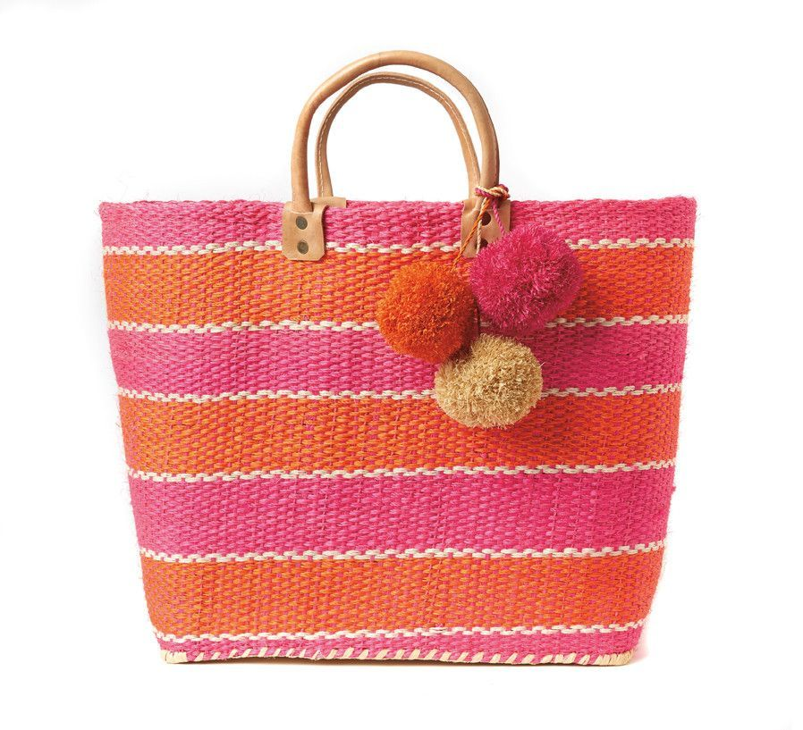 Capri Tote Bag – Favery -- Perfect for the beach, the market, or zipping around town, this beautiful basket tote bag, handwoven from sustainable sisal in vibrant graphic stripes, is adorned with festive raffia pom poms and features a sea grass lining, inner pocket, and durable leather handles.