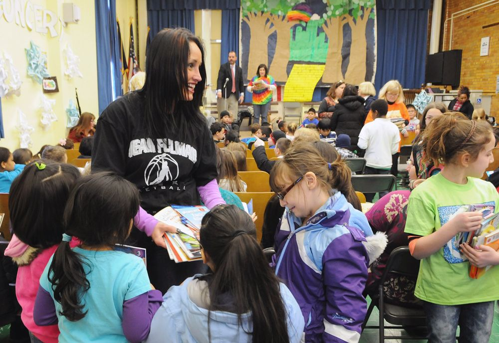A sea of new books after Sandy:  At Staten Island's PS 39 on Jan. 31, teachers from Mahopac, N.Y., distribute some of the 4,000 books delivered to three schools for children whose home libraries were wiped out by the hurricane.