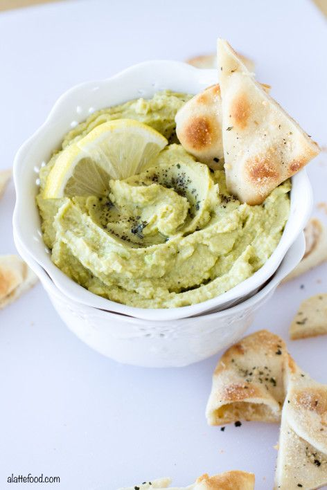 This homemade lemon pepper avocado hummus takes just a few ingredients and can be whipped up in minutes! Plus, these parmesan herb pita chips are seriously addicting.   www.alattefood.com
