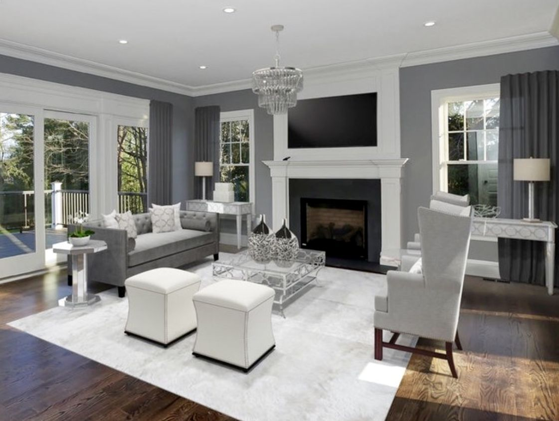 Traditional grey white living room decor with grey sofa ...