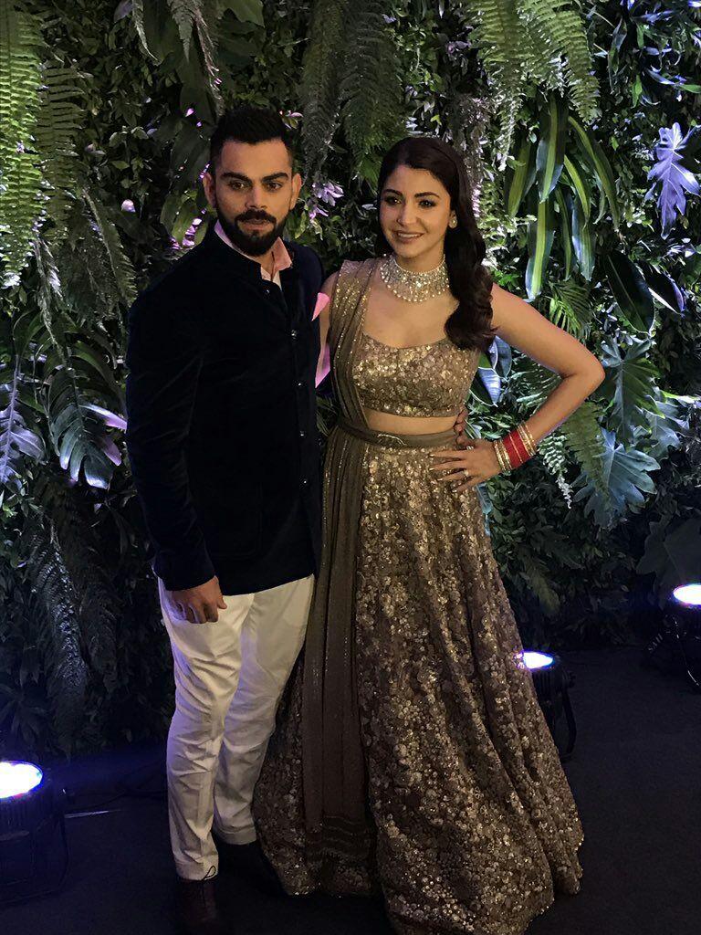 c033af30c072 Virat Kohli and Anushka Sharma at their 2nd Wedding Reception in Mumbai,  Dec, 2017, Anushka's in a Sabyasachi vintage style Lehenga with hand-beaten  silver ...