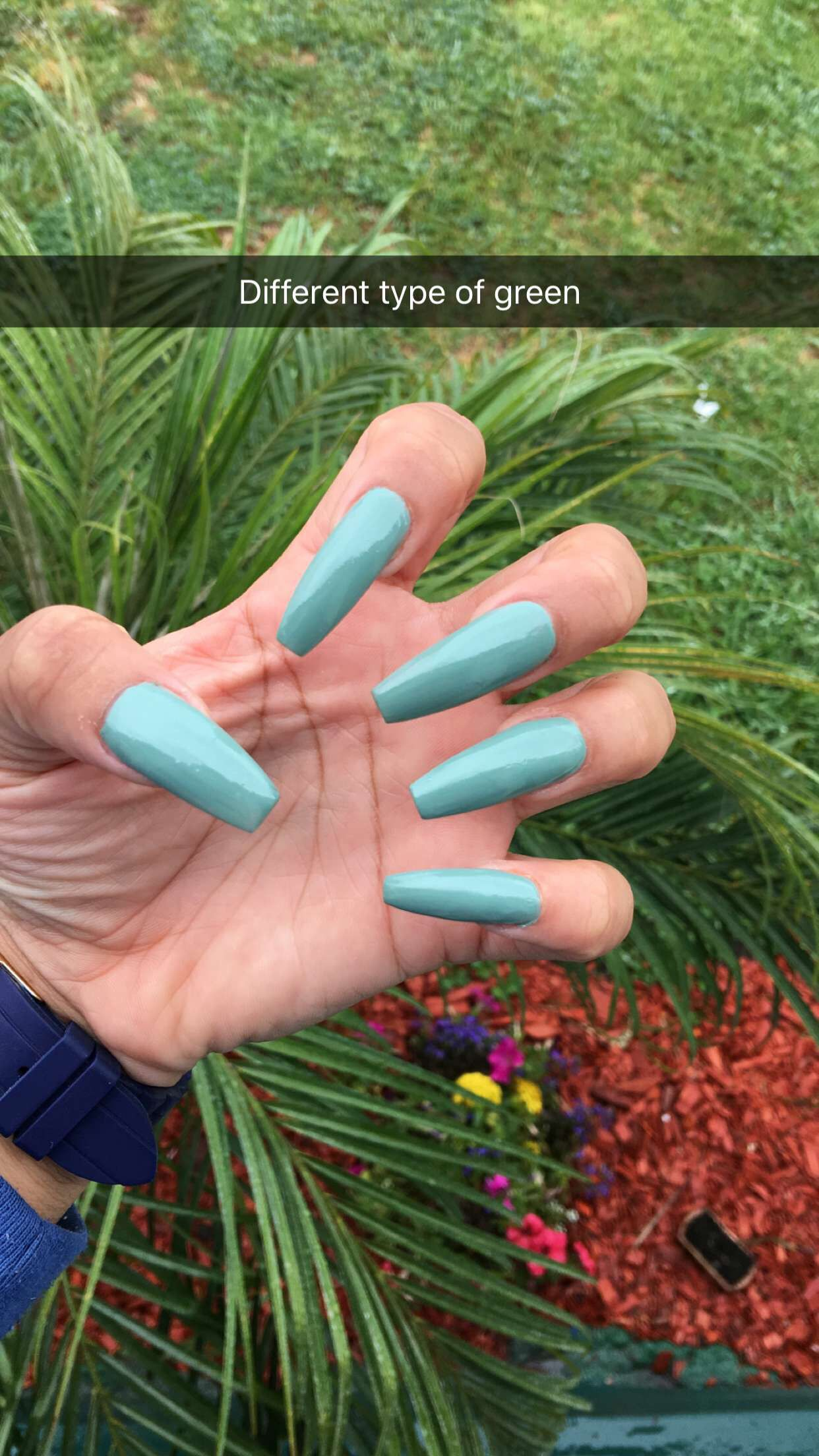 Long green coffin shaped nails.