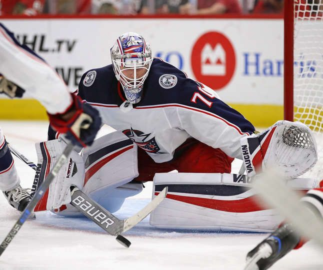 CHICAGO, IL - SEPTEMBER 23: Joonas Korpisalo #70 of the Columbus Blue Jackets makes a save against the Chicago Blackhawks during a preseason game at the United Center on September 23, 2017 in Chicago, Illinois. (Photo by Jonathan Daniel/Getty Images)