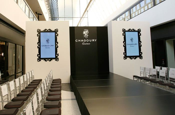Video Screens Surrounded By Black Decorative Frames Flanked The Runway Theme Fashion Show