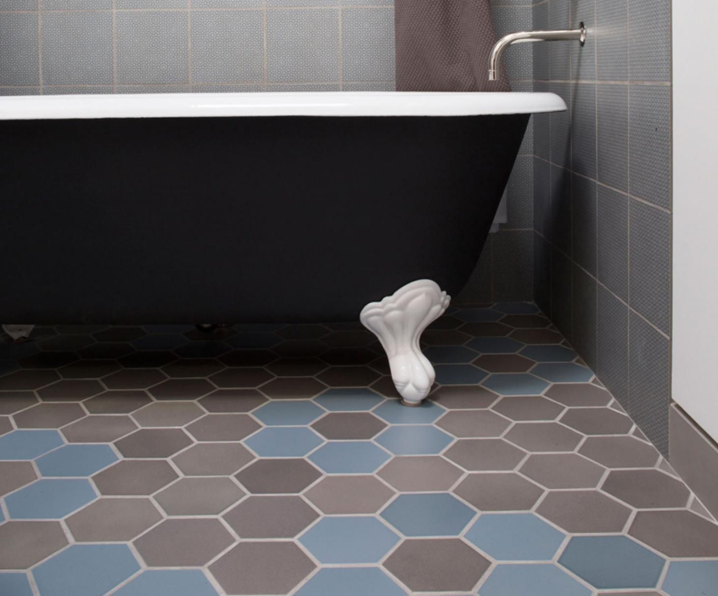 Mixing and matching shapes and glazes is harmonious in this mixing and matching shapes and glazes is harmonious in this bathroom features hex tile in blue fog variation and shade light variation heath ceramics doublecrazyfo Choice Image