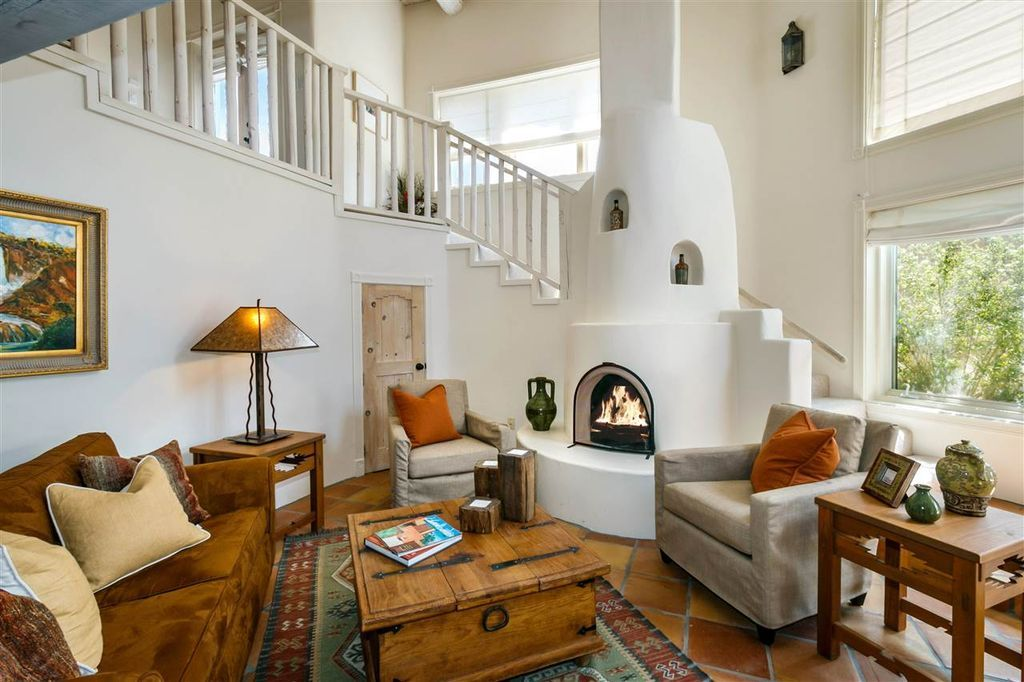 Southwestern Living Room With High Ceiling Cement Fireplace Extraordinary Southwestern Living Room Inspiration Design