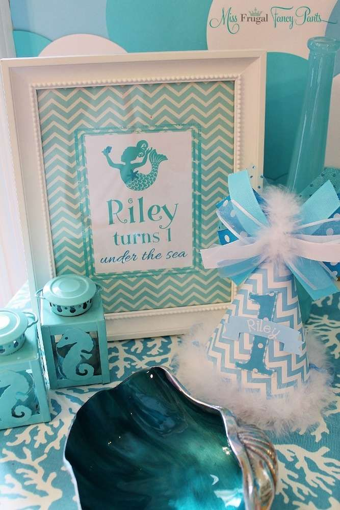 Pretty party decorations at a mermaid birthday party! See more party planning ideas at CatchMyParty.com!