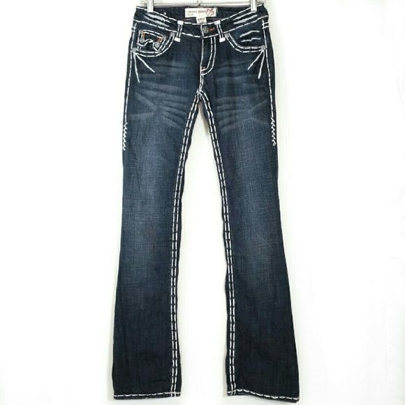 """Laguna Beach dark wash flare jeans * Prices are negotiable ☺  * Bundle to save!  Laguna Beach Jean Co., made in U.S.A.,  double white stitch, distressed dark wash flared, low rise jeans. Rear flap pockets with leather fleur-de-lis patches. - Size 27. Measurements laid flat:   Waist 15""""   Rise 8""""   Inseam 36"""" - Fabric: 97% cotton, 3% elastane  - Like new condition- no flaws #lagunabeach #lagunabeachjeans Laguna Beach Jean Co. Jeans Flare & Wide Leg"""
