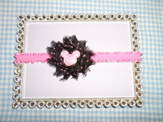 This is an adorable Minnie Mouse shabby flower headband. The black with pink polka dots shabby rosette is attached to an elastic ruffle headband