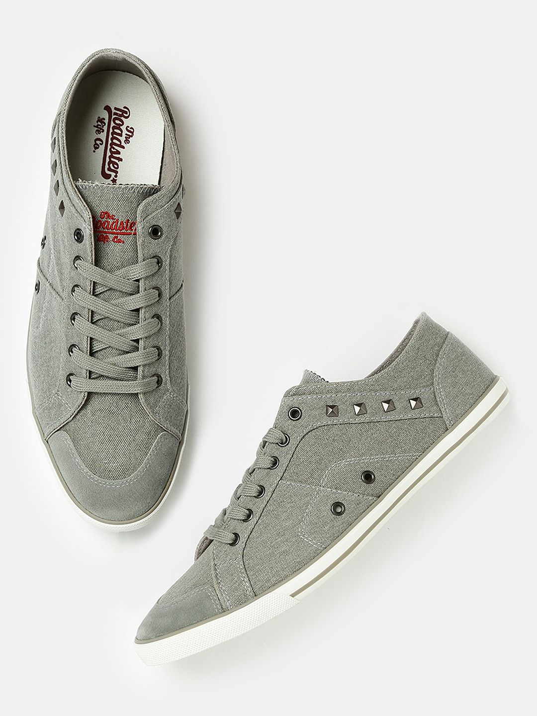 Buy Roadster Grey Canvas Solid Sneakers online in India at best price.