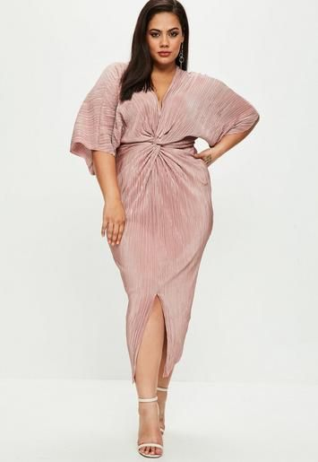 c87187534fa Plus Size Dresses. This blush pink dress features a metallic shimmer