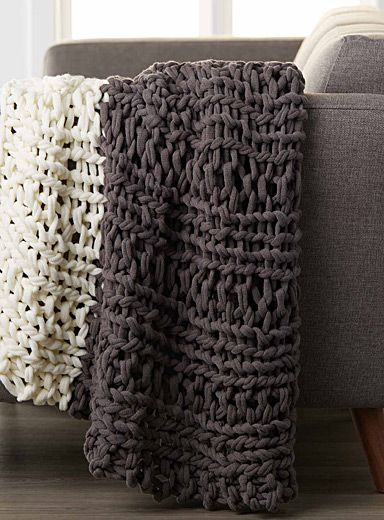 Exclusively from Simons Maison     A beautiful voluminous and fluffy handmade like throw with knotted and braided texture that warms up any room in the house.    Charcoal and ivory two-tone combo   Matching cushion also available   130 x 150cm