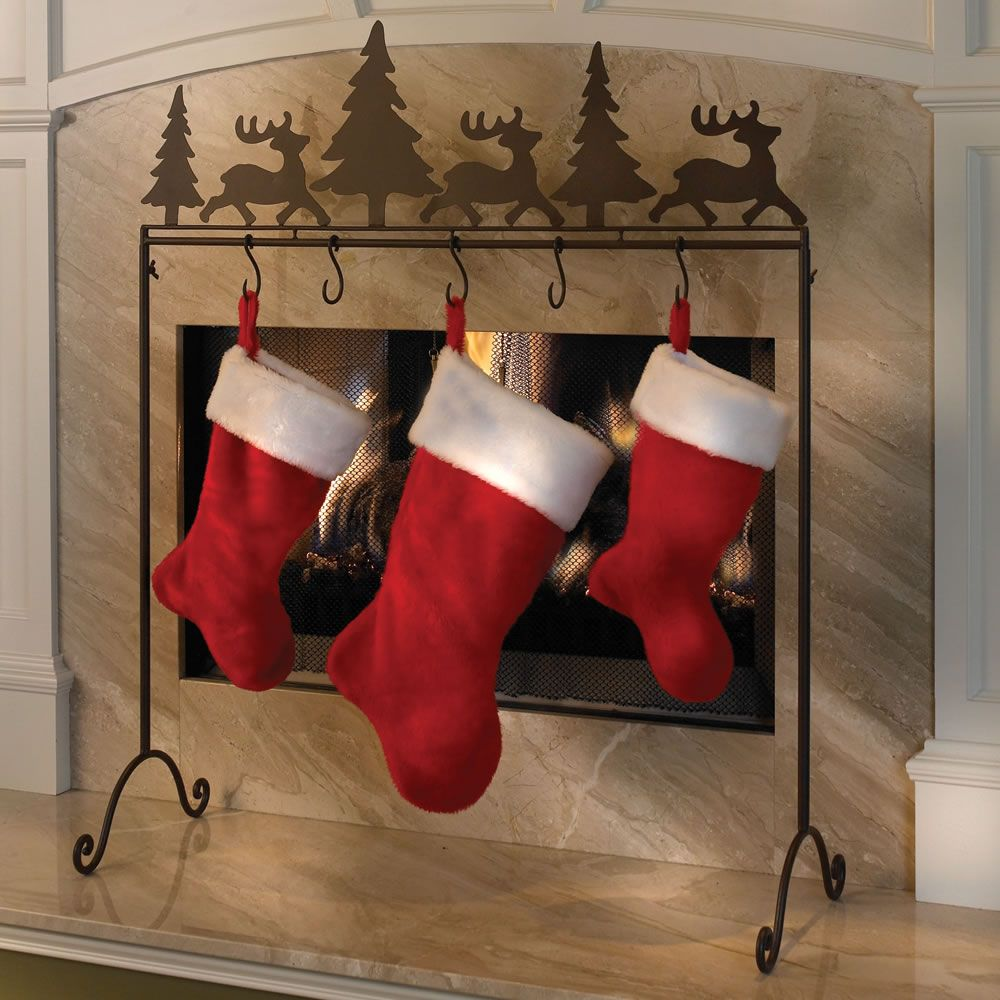 the place anywhere stocking holder more stable than hooks that perch precariously atop a mantel this wrought iron stand safely displays christmas