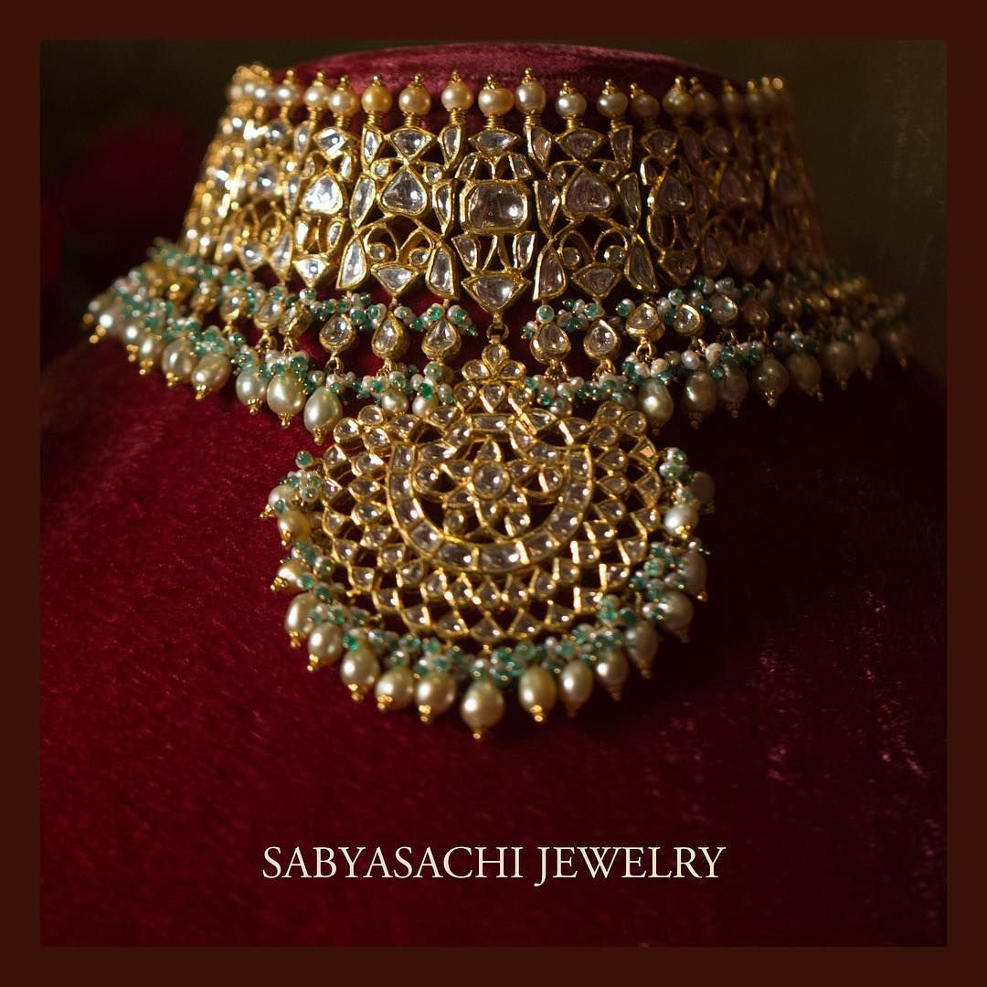A classic Sabyasachi choker set in 22k gold with uncut diamonds and