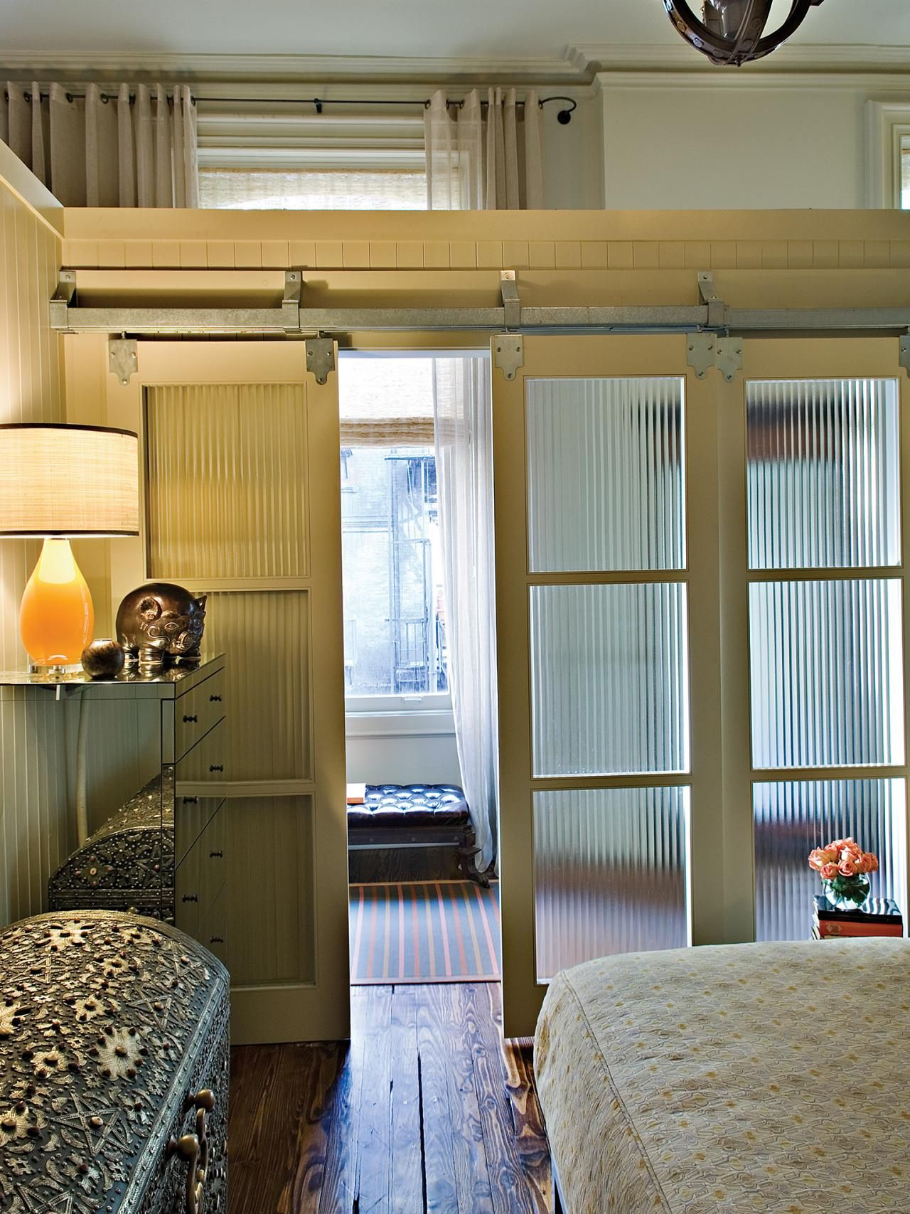 transitional bedroom with sliding glass doors