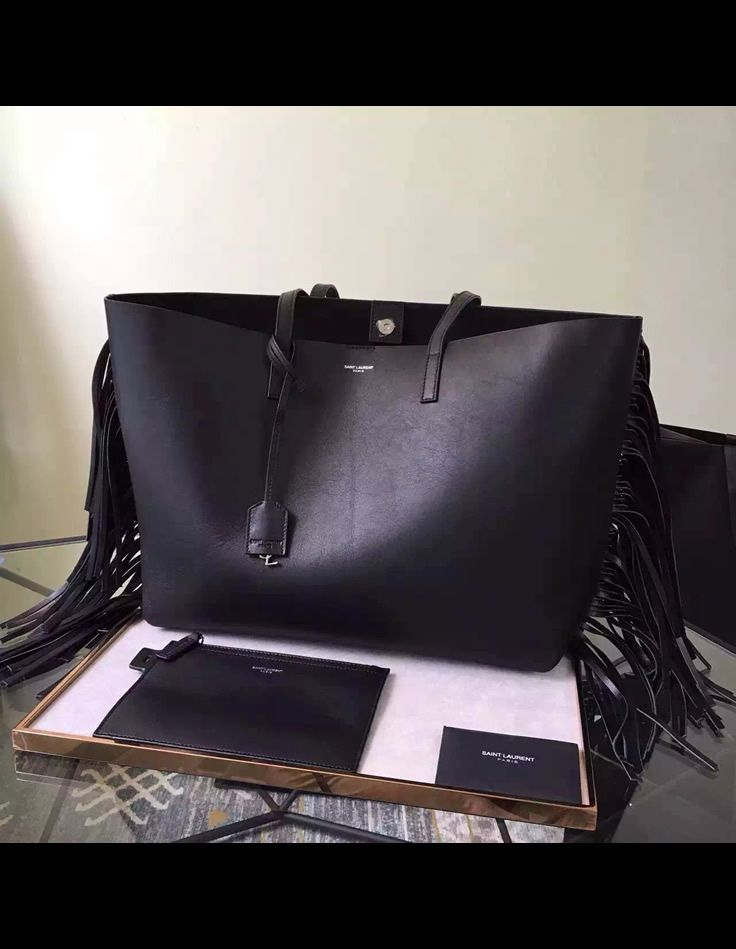 ec497515a3 Saint Laurent Large Shopping fringed tote bag is a classy and minimalist  bag that can go