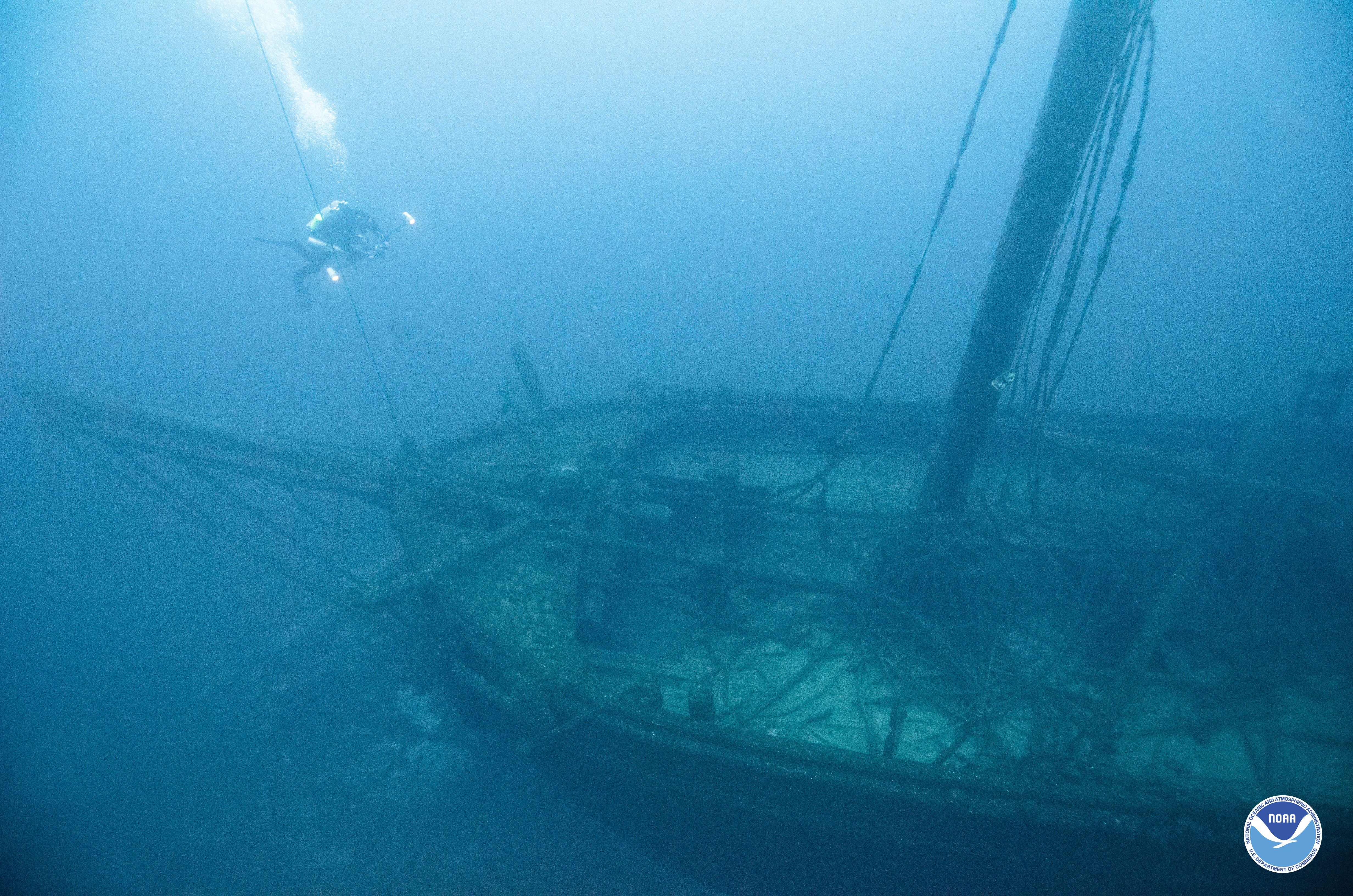 The TYPO sank in October of 1899 after being run down by another schooner. Today, the TYPO sits upright in the water with evidence of its quick sinking still present. The cargo is still on board and the ship's bell can still be seen in the belfry. Learn more about this shipwreck from Thunder Bay National Marine Sanctuary.