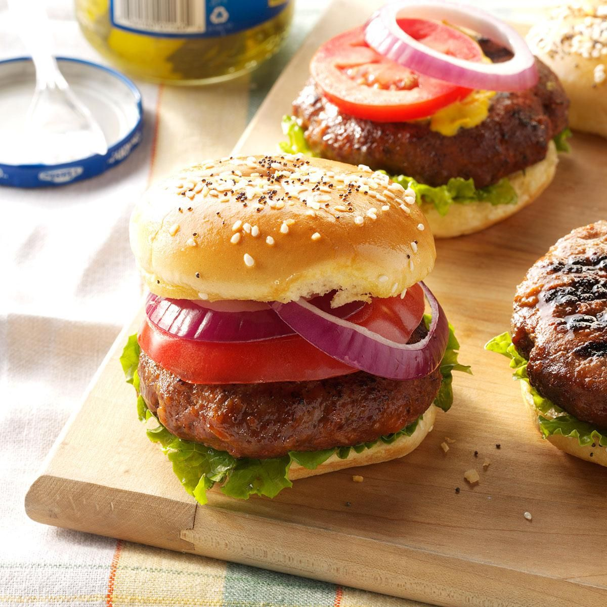 Dad's Cola Burgers Recipe -Before you hand out the drinks, save a little soda to make these burgers. Cola helps soften the texture and kick up the flavor. Used in the meat mixture and brushed on during cooking, it takes this football favorite to another level. —Emily Nelson, Packers Women's Association, Green Bay, Wisconsin