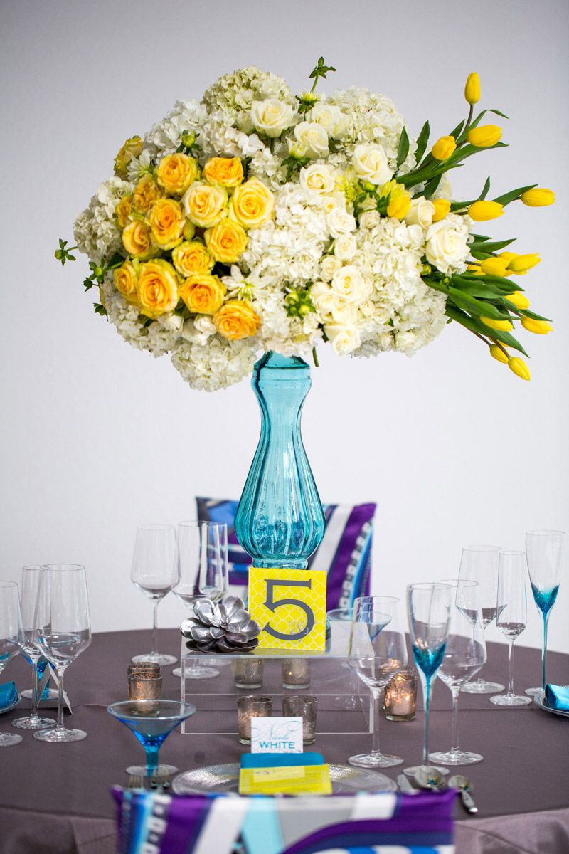 Fun, tall floral centerpiece. Photo by John Cain Photography. www ...