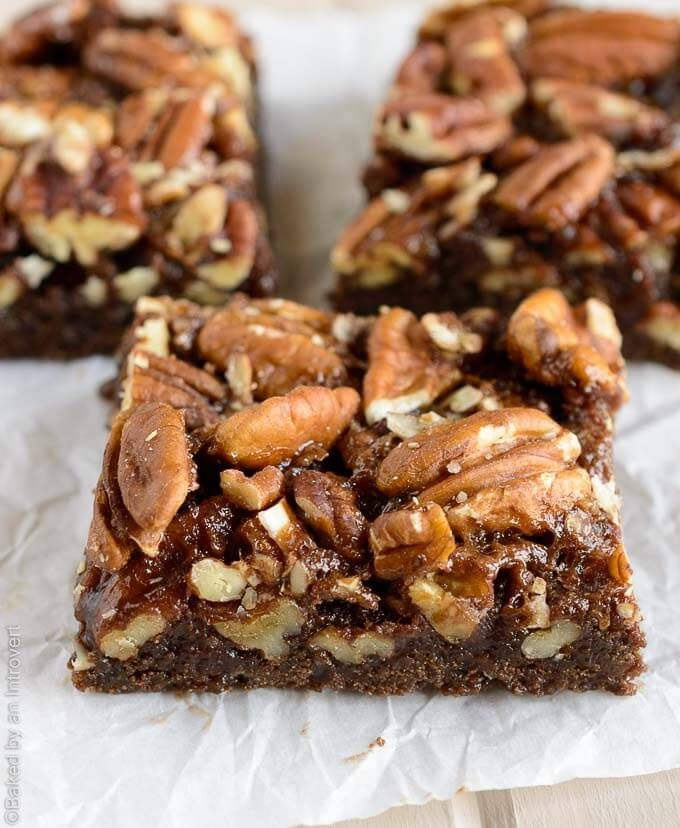If you like pecan bars, you will go nuts for this bourbon and chocolate version! These chocolate bourbon pecan bars are soft, chewy, crunchy, and gooey. They're unlike any other bar dessert I've made. | @introvertbaker bakedbyanintrovert.com