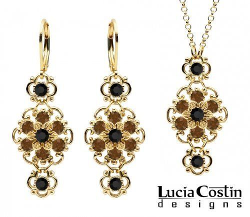 Lucia Costin Pendant and Earrings Set Made in 14K Yellow Gold Plated over .925 Sterling Silver with Twisted Line Accents, Black and Brown Swarovski Crystals, Crafted with 4 Petal Flowers Lucia Costin. $125.00. Flowers and fancy ornaments beautifully combined. Amazingly designed with black and brown Swarovski crystals. Lucia Costin delicate jewelry set. Handmade in USA unique jewelry set. Style takes wings in this lovely jewelry set that have a graceful flower shape