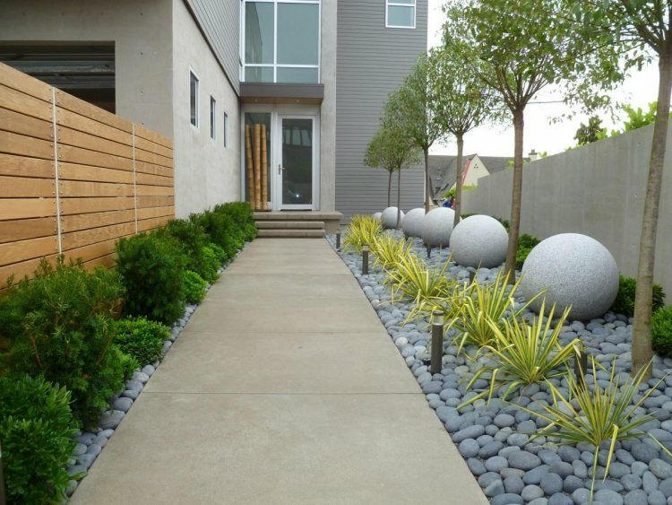 Jardines modernos decorados con piedras arquitectura for Jardines de patios modernos