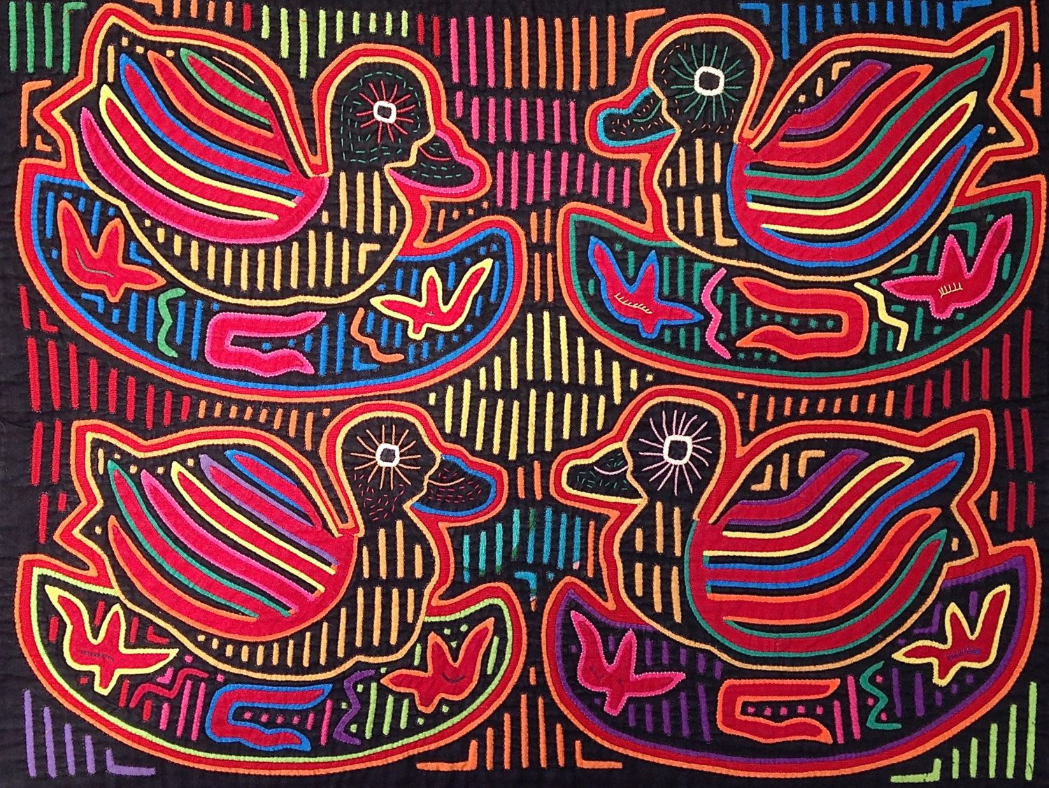 RECENTLY REDUCED FROM $205 to $185 ! The Four Ducklings mola is truly a masterpiece...older collectable molas are very rarely found in this pristine condition. This mola was made in the early 1960s, and is a perfect example of the Cuna art at its very height. The remarkable design is very skillfully executed. Take a close look at the tiny stitches, the complexity of the pattern and the fact that every square inch of the panel is decorated! This degree of skill, design, and condition is not…