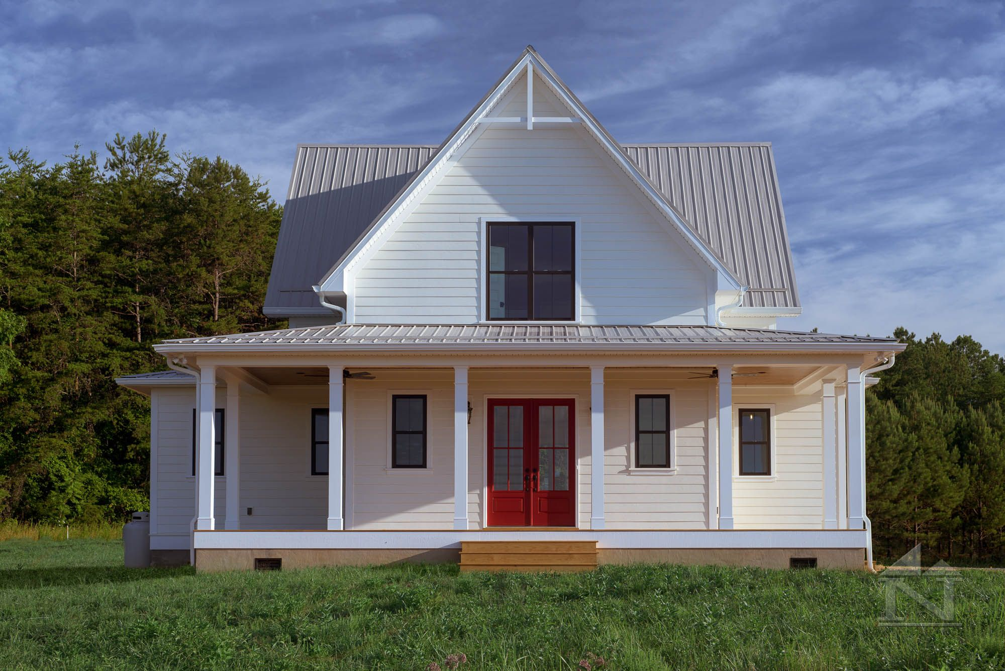 Farmhouse with metal roof. Custom home built by North