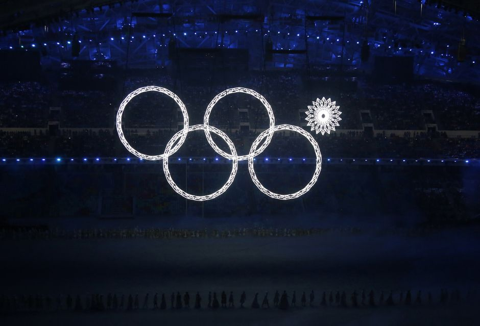 Four of the five Olympic Rings are seen lit up at the start of the opening ceremony of the 2014 Sochi Winter Olympics, February 7, 2014. REU...