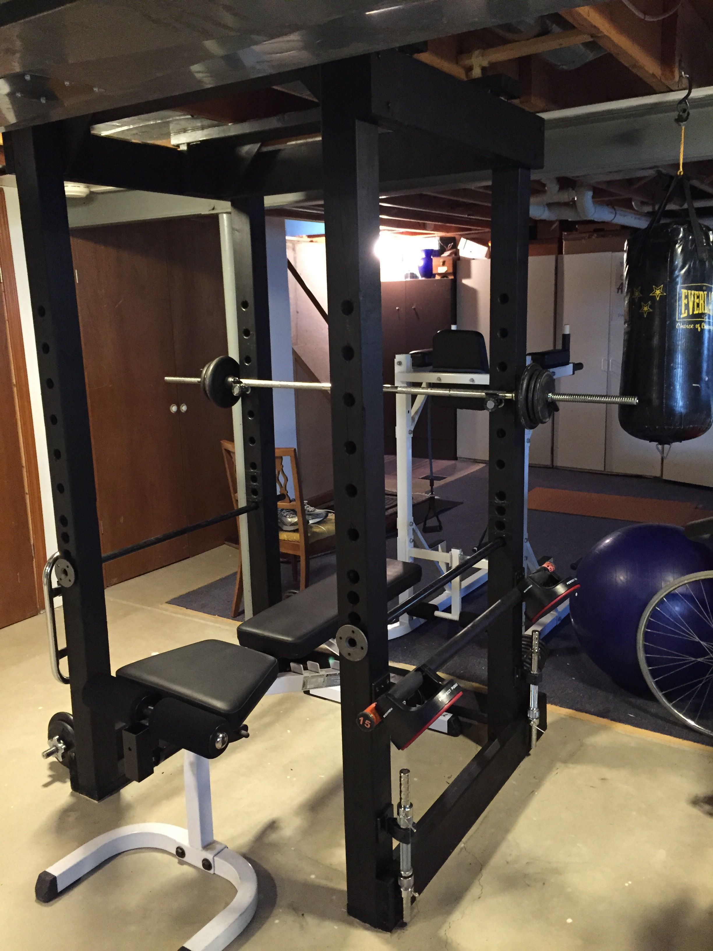 homemade power rack with adjustable safety bars, rack
