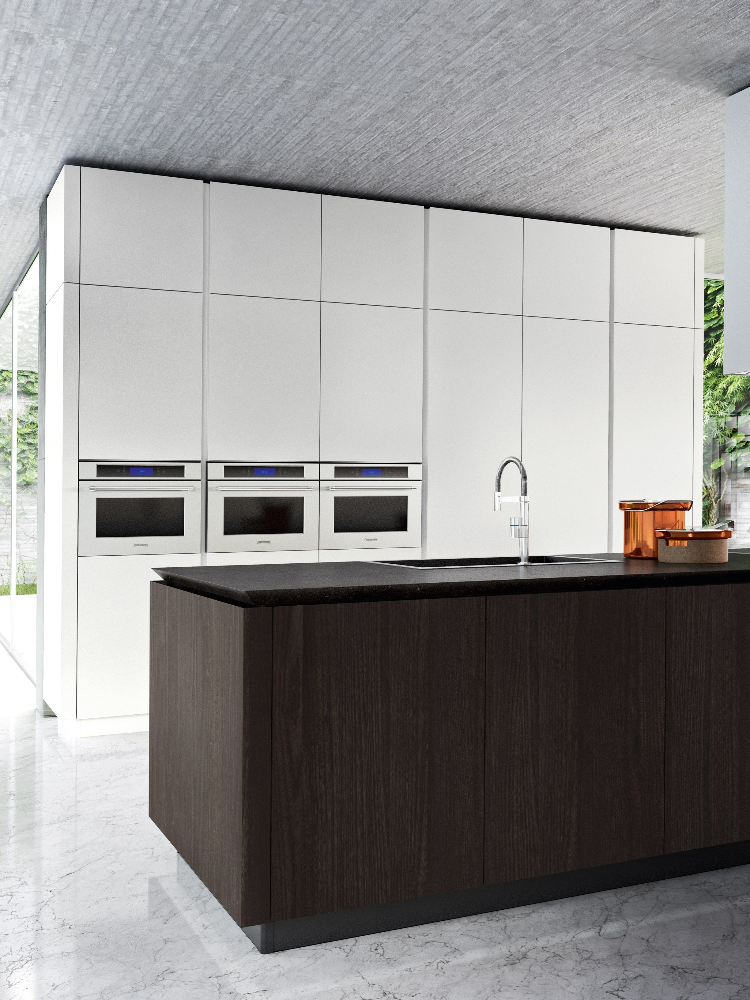 Adding a large island can help the fluidity of the kitchen triangle ...