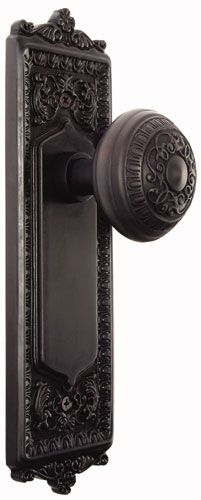 old door hardware used for coat or towel hook....so intricate ...