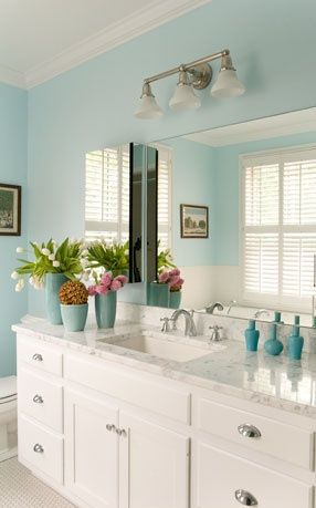 Photo of Such a soothing light blue bathroom with marble surfaces. Home and lifestyle …