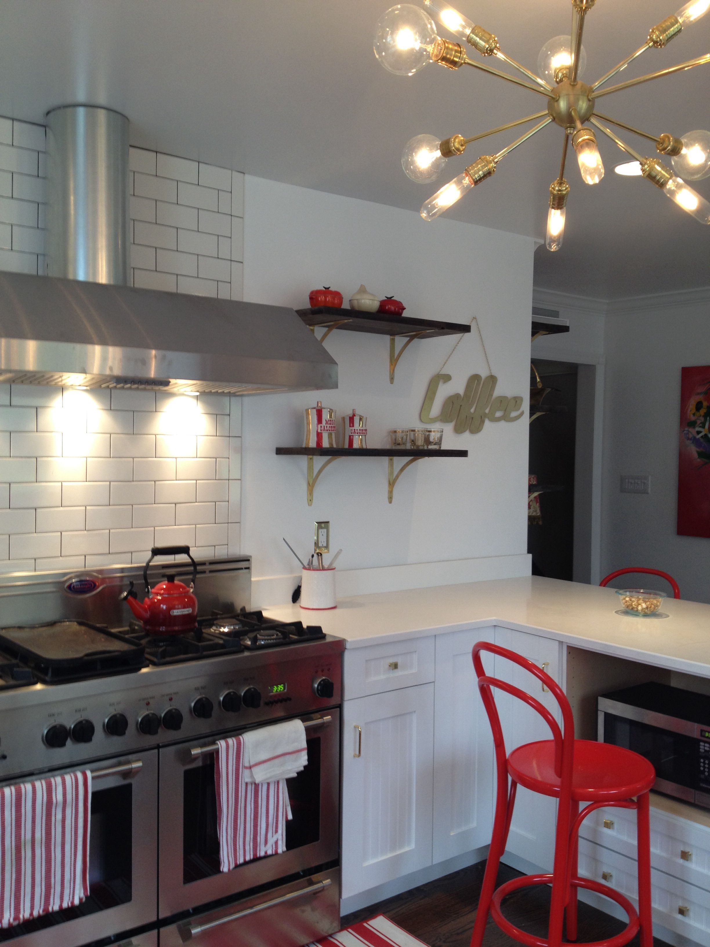 White Kitchen Project Complete With Sputnik Chandelier & Red Accents