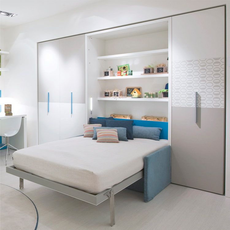 The Altea Book Sofa is a vertically opening wall bed system that