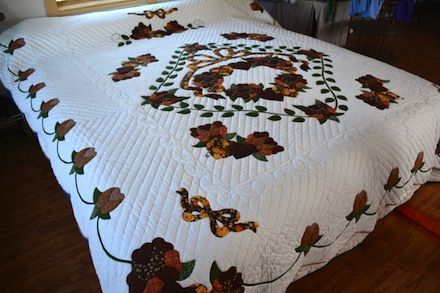 Amish applique quilt country roses in rich earth tones over bright