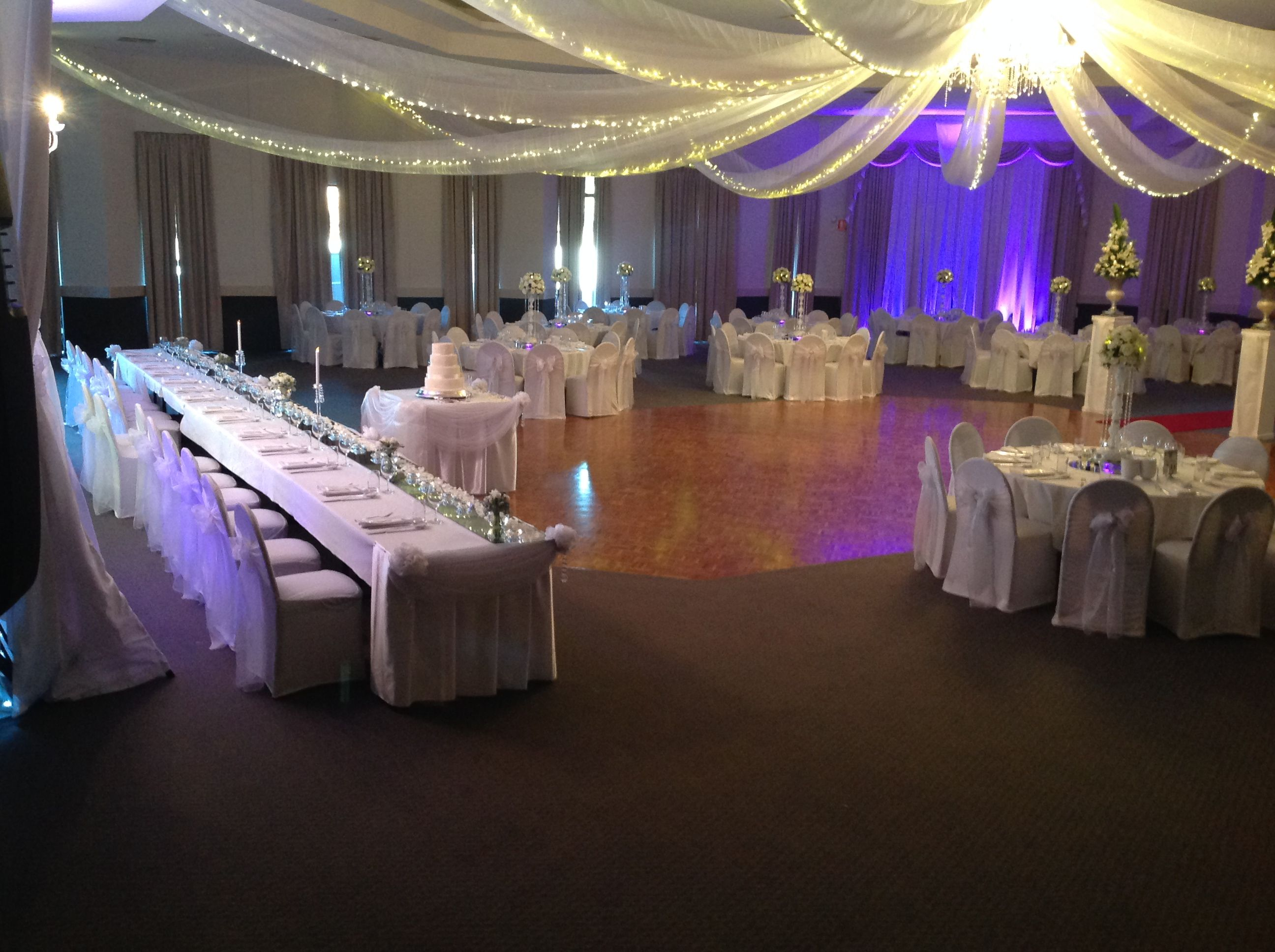 Wedding reception decoration with ceiling swags fairy lights wedding reception decoration with ceiling swags fairy lights chair covers with sashes bridal junglespirit Image collections