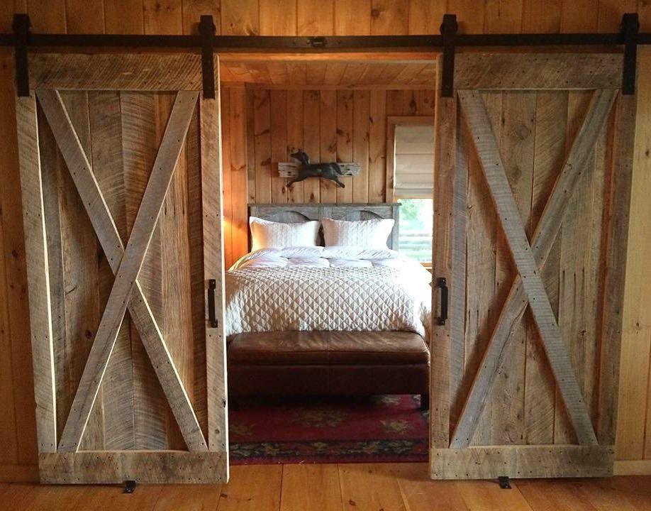 We love this gorgeous rustic bedroom. The Bi-parting barn doors ...