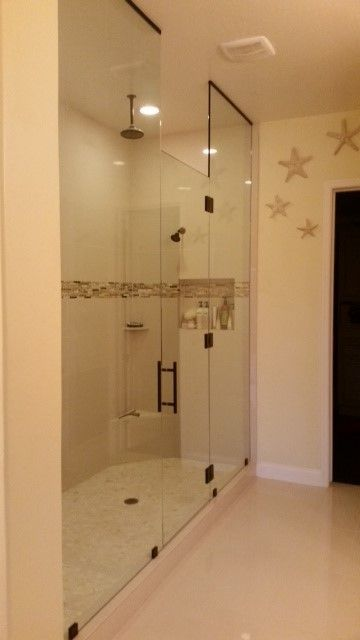 Tall Glass Panels With Glass Shower Door And Oil Rubbed Bronze