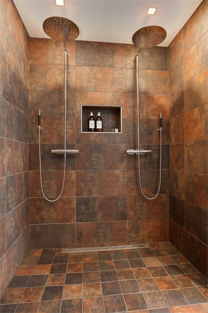Shower With Dual Shower Heads A Rain Shower Head A Bench And