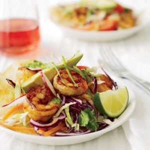 To create this Southwestern-inspired dish, Melissa Rubel Jacobson tosses shrimp with chipotle chile powder (made from dried, smoked jalapenos), grills them, then layers them on top of crunchy fried corn tortillas and crisp, citrusy slaw.