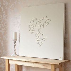 Crafty Things and DIY / Wooden letters glued to canvas and then painted over in white.
