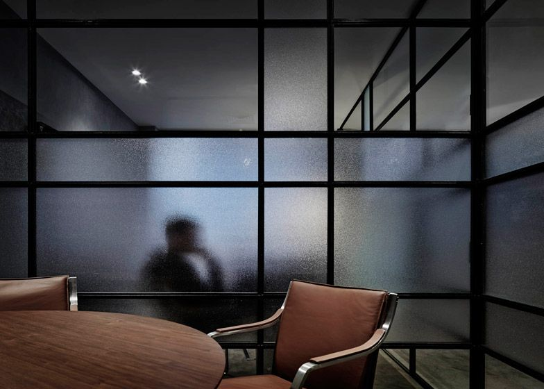 Relaxed  office created for a mortgage broker using soft lighting and frosted glass. & B.E. Architecture create