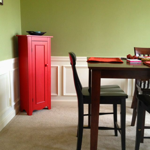 Dining room green walls red standing cabinet chair rail