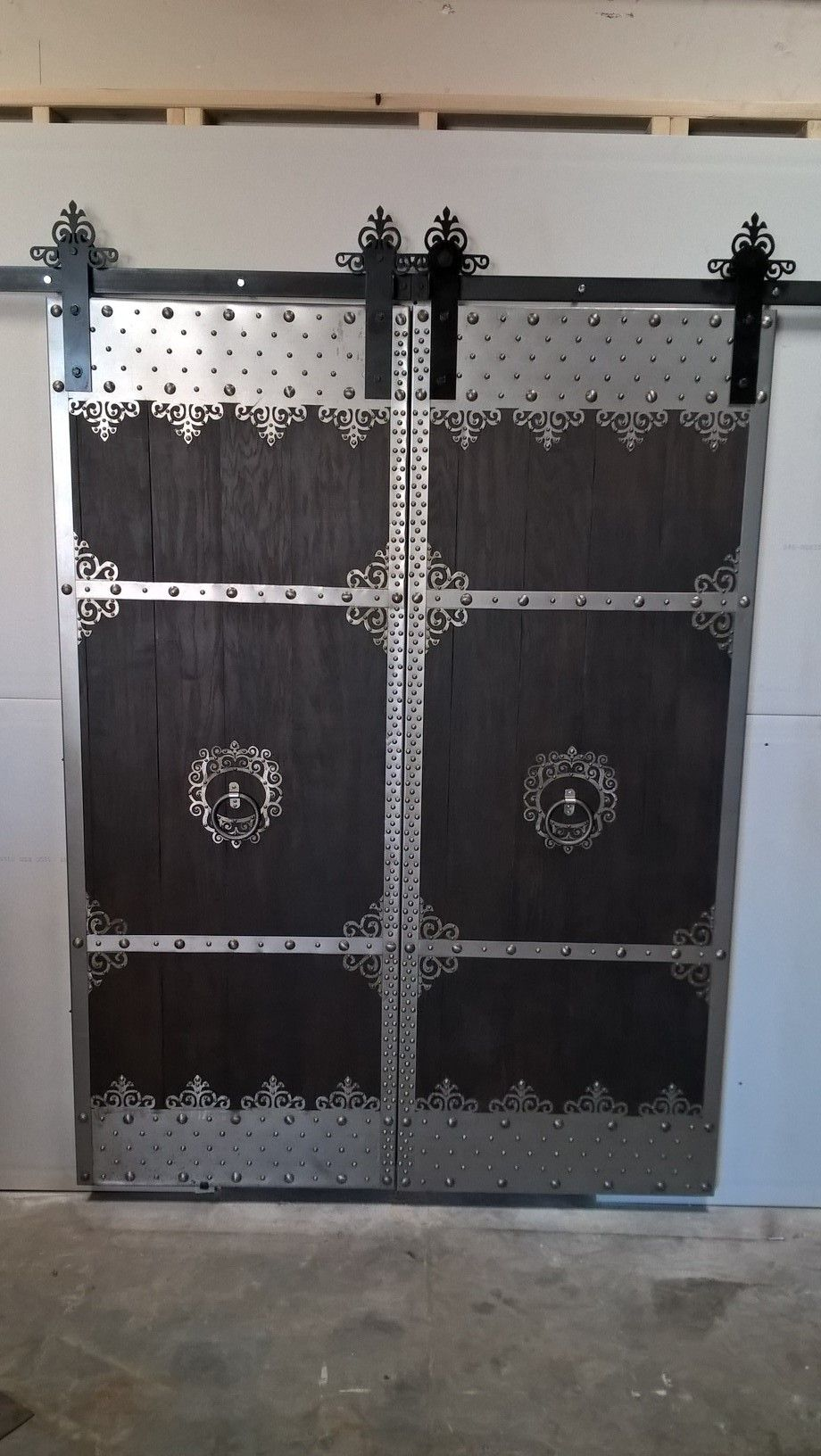 Created and brought to life in the Artfully Rogue workshop. These 80  x 32  oak doors are accented with 22 gauge sheet steel filigree and designed to slide ... & Created and brought to life in the Artfully Rogue workshop. These 80 ...