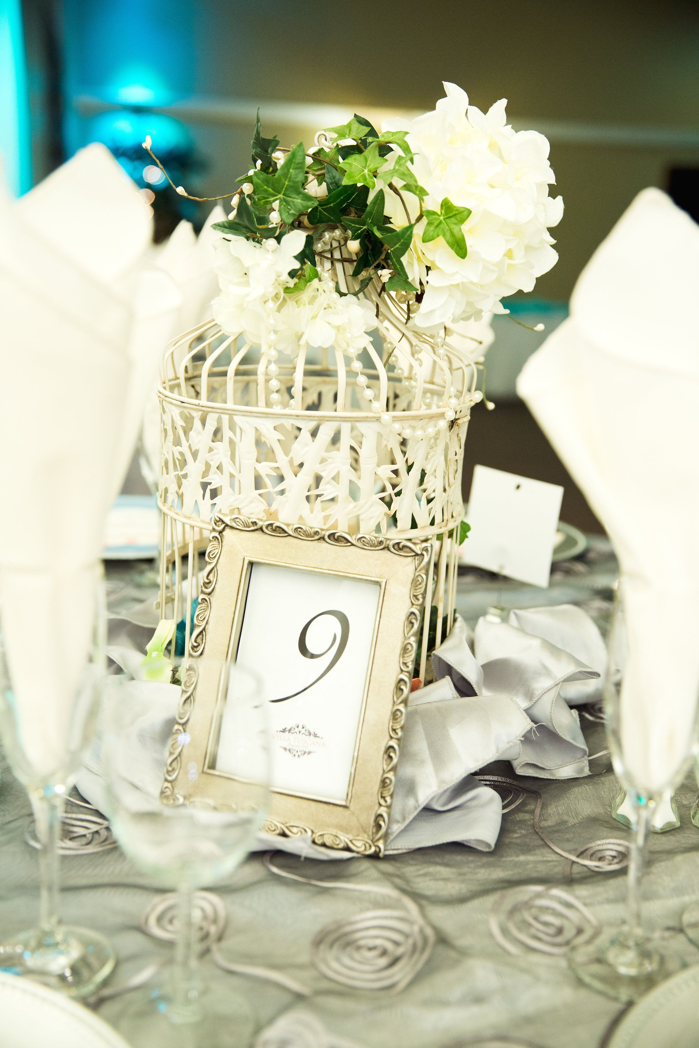 Bird cage with florals on top make for an elegant and trendy ...