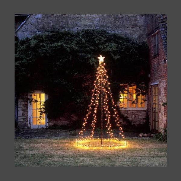 Haute design by sarah klassen christmas traditions trees cest cox cox light tree tower availability in stockx tree this beautiful outdoor tree complete with star and static lights will bring magic to workwithnaturefo