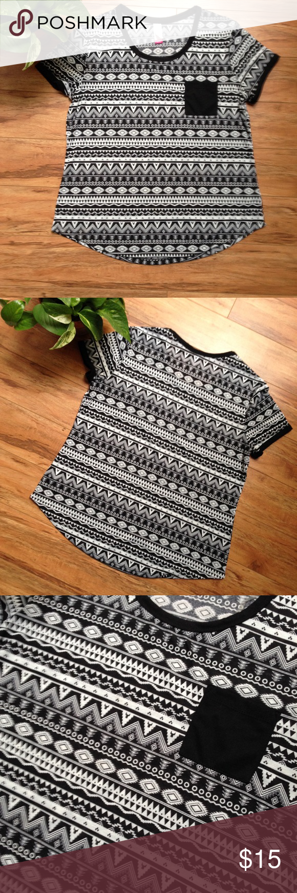 Tribal Print Pocket Tee Black and white tribal print with pocket tee.. Size xl(true to size) new never worn without tags..if you have any questions feel free to ask❤️NOT BRANDY Brandy Melville Tops Tees - Short Sleeve